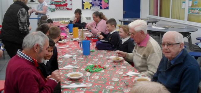 Elderly residents join Bells Farm children for Christmas lunch