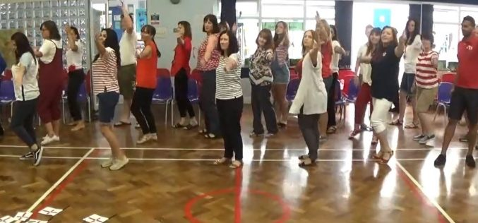 Video: Staff Surprise Performance and Flossing